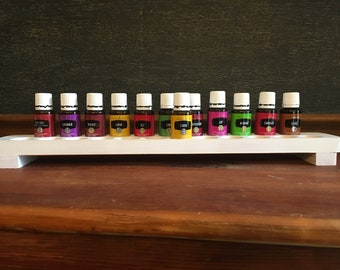 Essential Oil footed 1 Tier rack, white distressed pine. holds 23 lg (15ml) bottles