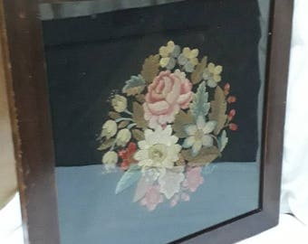 Framed needlepoint and crewelwork display of flowers on black needlepoint background