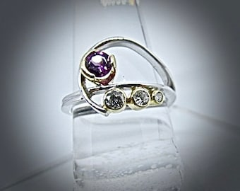 14k white and yellow gold garnet and diamond ring