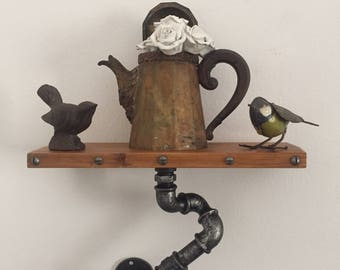 Vintage Industrial style shelf/shelf in hydraulic pipes.