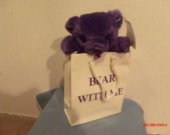 Purple Bear in Bag marked Bear with Me.