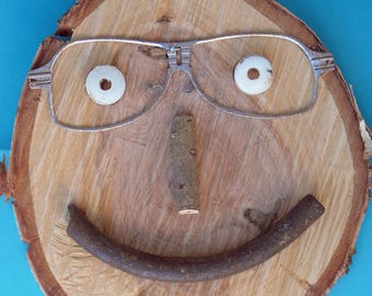 face on birch wood slice, large art, round art, eyeglasses, recycled art, mixed media, smile face, smile face, kitchen art, found items