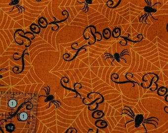 "Spiders and webs and Boo in black on orange with a little sparkle 44-45"" wide 100% cotton"