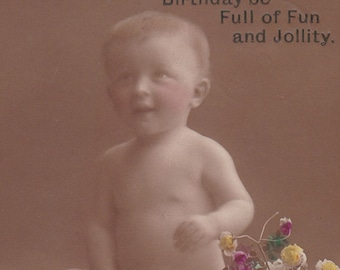 SALE 1900s Postcard, Edwardian baby with flowers, RPPC real photo, paper ephemera. Price reduced.