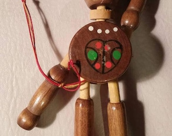 Native Canadian string wooden marionette