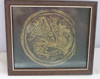 Gold Welsh dragon on black photo paper framed