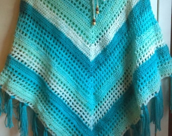 Handmade crochet poncho in greens and white