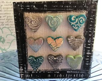 mixed media art with blue hearts- polymer clay hearts on art block