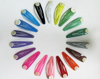 15 assorted snap hair clips with a glue on pad (one of each color) C49