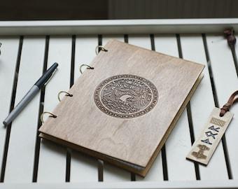 Wooden notebook with scandinavian god Thor and Drakkar