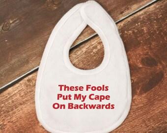 "Baby Bib - ""These Fools Put My Cape On Backwards"" - Batman Baby Bib"