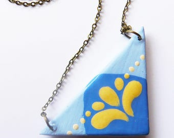 """Palm"", handcrafted ceramic triangle graphic Blue and yellow necklace, handmade"