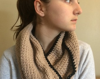 Warm tan cowl with black trim