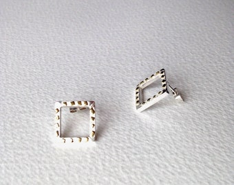 Hollow square earrings in silver and gold