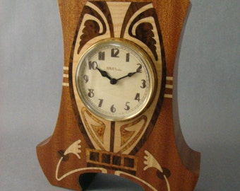 Clock with Art Deco/Nouveau Theme. MC30 Free Shipping within the U.S.