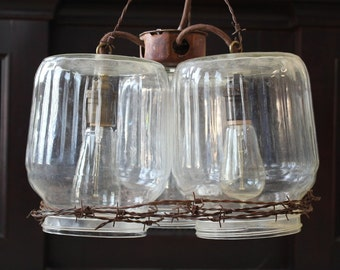 Hanging Light: 3 Glass Chicken Gallon Drinkers and Barbed Wire