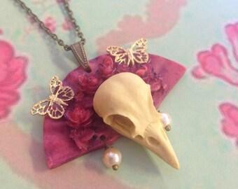 Necklace crane d poseau on her purple fan