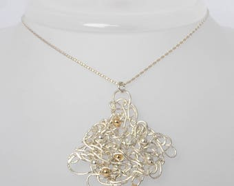 pure silver necklace, pure pendant shooting of pure silver wire with gold and silver beads