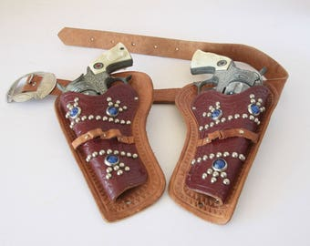 Pair of Vintage Metal Hubley Texan Cap Pistols with Leather Holsters and Belt mid century