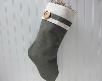 Green burlap stocking with large wood button