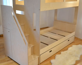 Loft bed nested with a twin bed and trundle
