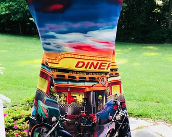 Men's apron featuring a motorcycle and hot rids in front of a diner.