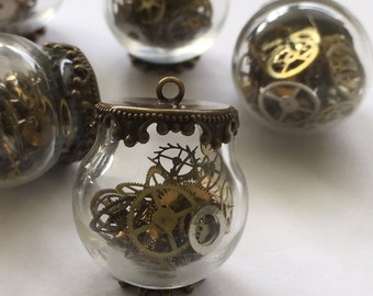 Steampunk glass necklace with watch gears