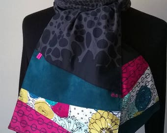 Black fabric scarf, fuchsia and teal.