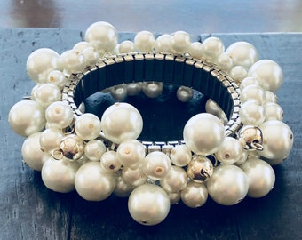 Pearl Jam Silver - faux pearl stretch cha cha style bracelet with silver toned beads and white faux pearls; silver plated stainless base