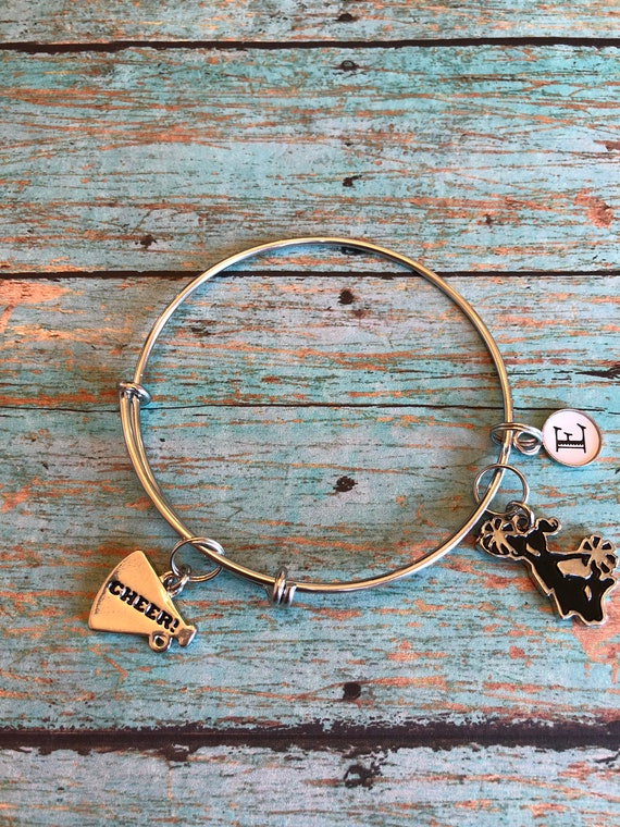 Expandable bangle bracelet with cheerleader charms