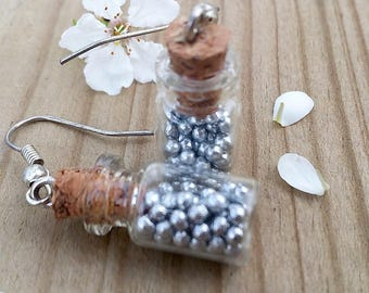 Vial filled with candy earrings
