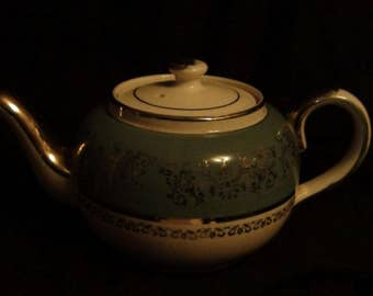 vintage sadler turquoise,white, and gold teapot