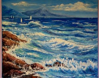 Stormy blue sea with rocks