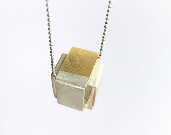 Silver chain with square pendant with golden detail