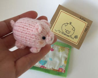 One very very cute hand knitted Piggy