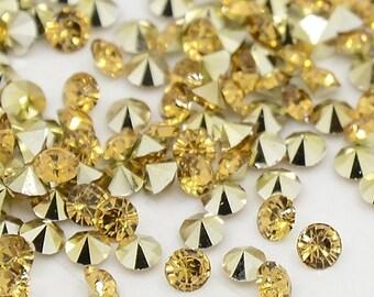 24 rhinestones SS23, resin, Ø5mm, gold topas