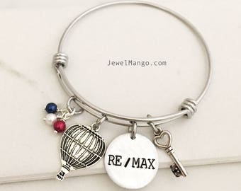 RE/MAX realtor gifts, Remax agents Reality, real estate, agency, blue, red, white logo color, key necklace, hot air balloon, bangle bracelet