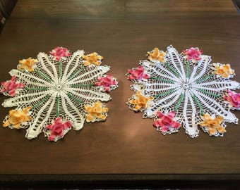 Set of two floral doilies.