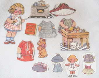 """Older Dolly Dingle Paper Doll 13 PC Kitchen Cooking Stove Hats Dog & More 5 1/2 """" T27"""