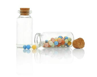 Glass bottles with corks, filling, different sizes