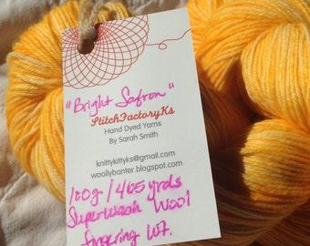 Hand Dyed superwash Sock yarn in Bright Safron