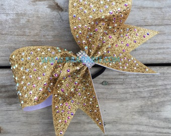 Vegas gold glitter bow with gold and AB rhinestones.