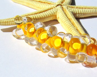 SMAUGGS handmade beadset BOBBELS (10pcs., 15mmx7mm), glass, yellow, transparent, hole 2mm