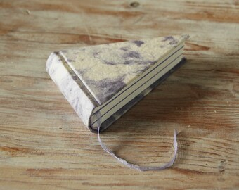 piece of pie book in handcrafted off white paper with purple