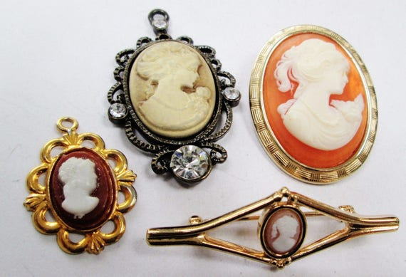 Lovely vintage collection of Two vintage cameo brooches  and 2 cameo pendants