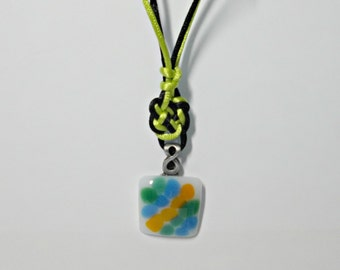 Fused glass pendant necklace; white glass with green, blue, and orange striped rainbow