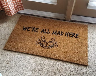 We're All Mad Here | Alice in Wonderland | The Mad Hatter | Cheshire Cat | Wonderland Decor | Cat Doormat | Welcome Mat | Funny Doormat