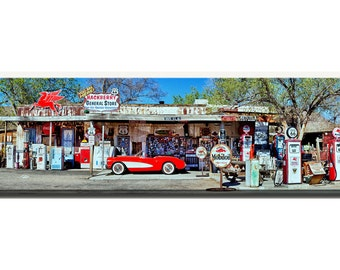 Red vintage corvette and gas station pumps and antiques on Rt66 in Hackberry, Arizona.  Size 12 x 36 or 20 x 60 inch canvas photography