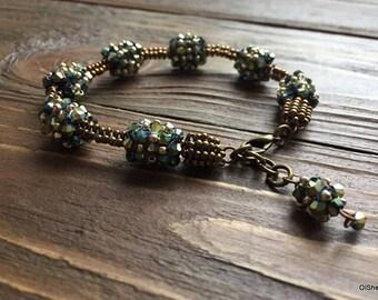 Bracelet of bronze-colored beads.