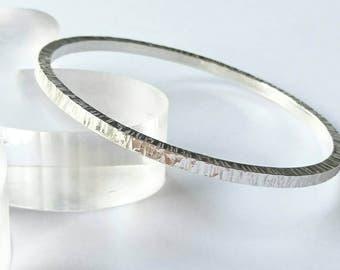 Sterling silver handmade square wire round textured bangle, hallmarked in Edinburgh.